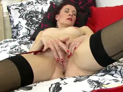 Red lipstick looks classy on a masturbating milf videos