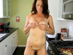 Housewife making pancakes and stripping in the kitchen videos
