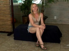 Playful blonde milf spreads her legs and flashes videos