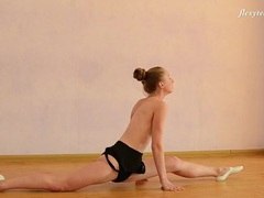 Blonde ballerina stretches and bends in the nude videos