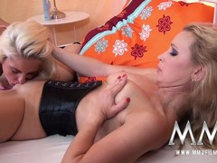 Hot blonde lesbian in a tight corset enjoys a tongue videos