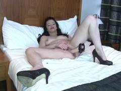Sexy mature brunette sits on a long dildo videos
