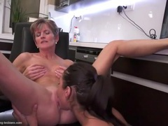 Teen licks a mature lesbian in the office movies