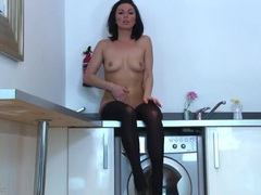 Stunningly sexy milf in stockings masturbates movies at adipics.com