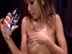 Japanese girl coats her body in oil tubes at japanese.sgirls.net