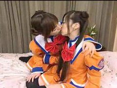Japanese girls in costume kiss and play tubes at lingerie-mania.com