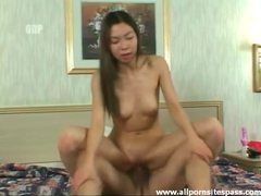 Slender asian beauty gets impaled on big cock tubes at asian.sgirls.net