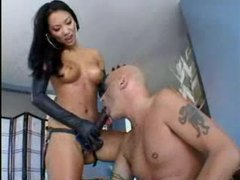 Asian in leather gloves makes him suck strapon tubes