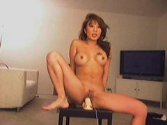 Asian chick sitting on her favorite toy movies at kilovideos.com