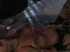 Tons of hot wax all over her while she sucks tubes at lingerie-mania.com