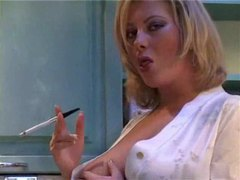 Busty chick in a satin robe in the kitchen movies at freekiloclips.com