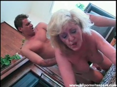 Mature wears lingerie as young guy fucks her videos