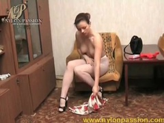 Sexy brunette puts on a pair of white pantyhose videos