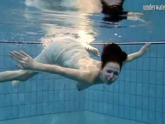 Swimming redhead with small breasts is cute videos