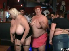 Fat women share their huge tits in the bar videos