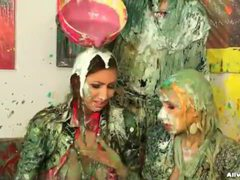 Paint and goo covers these clothed women videos