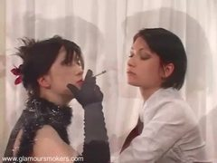Seductive lesbian couple in hot clothing enjoy smoking together videos
