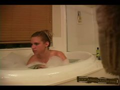 She gently masturbates in the bathtub movies at sgirls.net