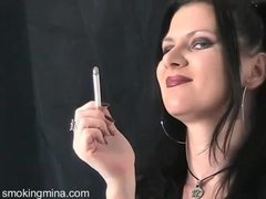 Dark makeup and lipstick on smoking goth girl movies at adipics.com