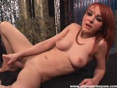 Redhead strips from lingerie to toy her pussy videos