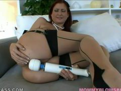 Elegant looking redhead milf sucking on a knob videos