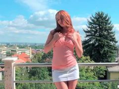 Perky redhead minx showing off her curves outdoor movies at kilotop.com