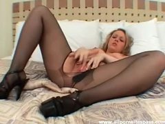 Petite blonde in pantyhose fingering her pussy videos