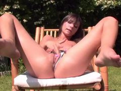 Daring babe rubs her wet pussy outdoors movies at kilopics.com