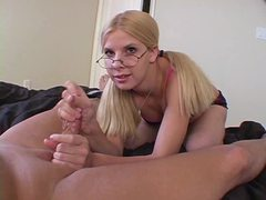 Pigtailed blonde with glasses pleasures cock with her hands tubes