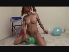 Pierced redhead hottie with tattoos rides balloon tubes