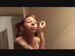 Heavily tattooed redhead with pigtails puts on makeup movies at very-sexy.com
