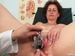 Mature in glasses takes speculum in pussy movies at lingerie-mania.com