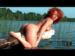 Curly haired redhead teases by the lake movies at kilotop.com