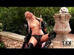 Kinky minx in latex fucks the hilt of a sword movies at sgirls.net