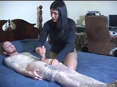 Dude in plastic wrap stroked by clothed girl videos