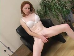 Sexy redhead penetrates pussy for fun movies at freekilomovies.com
