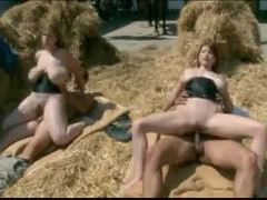 Two babes in corsets fucked in the hay movies at kilomatures.com