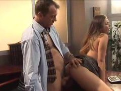 Young lady in a dress has sex at the office movies