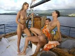 Two sluts fuck the boat captain clip
