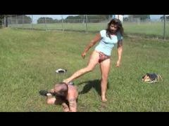 Girl kicks and beats on a guy outdoors tubes
