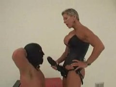 Dominant chick with huge strapon fucks slave tubes
