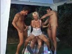 Retro gangbang of a babe in white lingerie videos