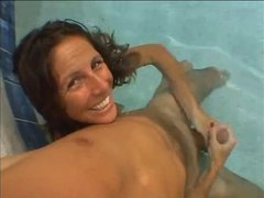 She gives a handjob underwater movies at sgirls.net