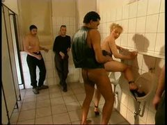 Fucked in bathroom as guys watch videos