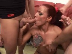 Inked up redhead in a big gangbang videos
