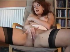 Redheaded milf in retro lingerie plays movies at kilopills.com