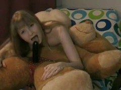 Amateur rides strapon attached to her teddy bear movies at lingerie-mania.com