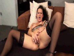 Slut in stockings masturbates with legs open tubes