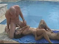Threesome next to the pool with great oral videos