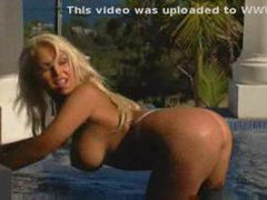 Blonde in pool stripping from bikini movies at freekilomovies.com
